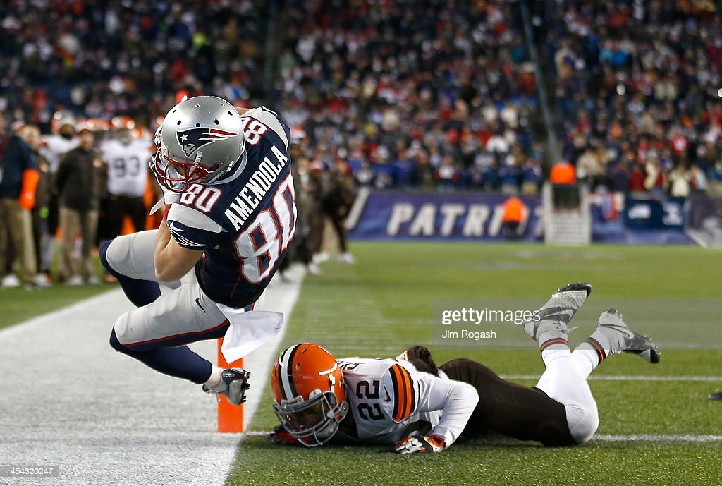 <a gi-track='captionPersonalityLinkClicked' href=/galleries/search?phrase=Danny+Amendola&family=editorial&specificpeople=2194309 ng-click='$event.stopPropagation()'>Danny Amendola</a> #80 of the New England Patriots scores a touchdown despite the defense of <a gi-track='captionPersonalityLinkClicked' href=/galleries/search?phrase=Buster+Skrine&family=editorial&specificpeople=6547689 ng-click='$event.stopPropagation()'>Buster Skrine</a> #22 of the Cleveland Browns in the 4th quarter at Gillette Stadium on December 8, 2013 in Foxboro, Massachusetts.