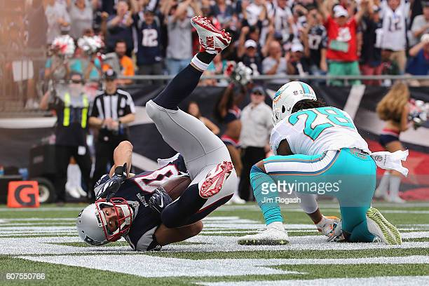 Danny Amendola of the New England Patriots scores a touchdown during the second quarter against the Miami Dolphins at Gillette Stadium on September...