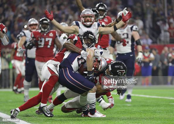 Danny Amendola of the New England Patriots scores a two point conversion late in the fourth quarter against Jalen Collins the Atlanta Falcons during...