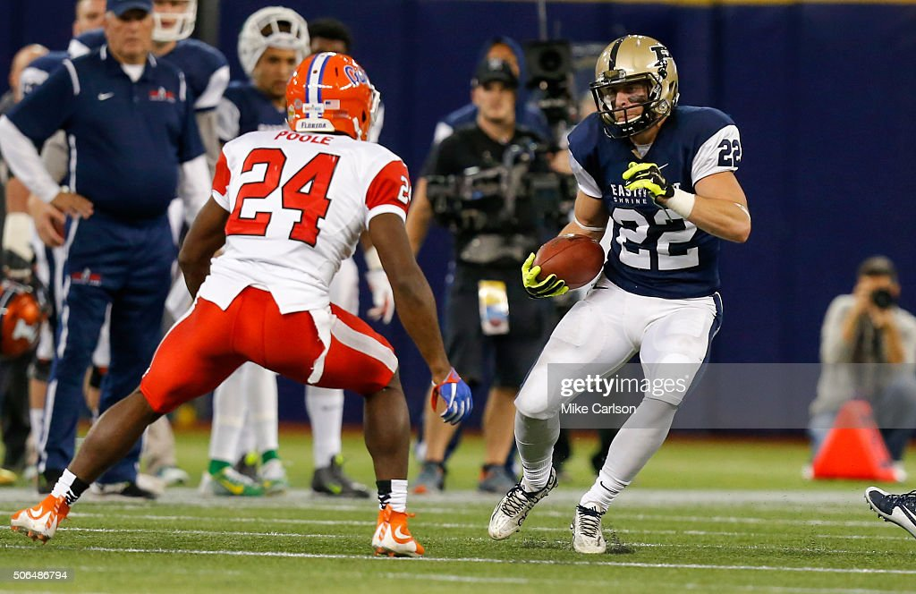 Danny Anthrop #22 from Purdue playing on the West Team looks past Brian Poole #24 from Florida playing on the East Team during the first half of the East West Shrine Game at Tropicana Field on January 23, 2016 in St. Petersburg, Florida.