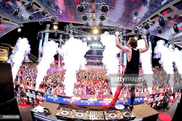 Danny Avila performs at the 'Nature One' massive rave held at the former US rocket base Pydna on August 1 2014 in Kastellaun Germany