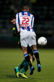 Danny Bakker of ADO and Hakim Ziyech of Heerenveen colide during the Eredivisie match between ADO Den Haag and sc Heerenveen held at Kyocera Stadium...