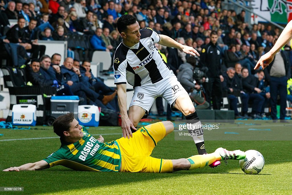 Danny Bakker of ADO Den Haag, Thomas Bruns of Heracles Almelo during the Dutch Eredivisie match between Heracles Almelo and ADO Den Haag at Polman stadium on May 01, 2016 in Almelo, The Netherlands