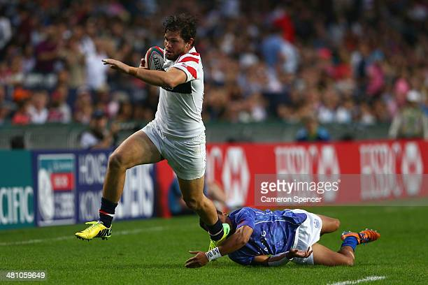 Danny Barrett of the United States makes a break during the Pool D match between Samoa and the United States during day one of the 2014 Hong Kong...
