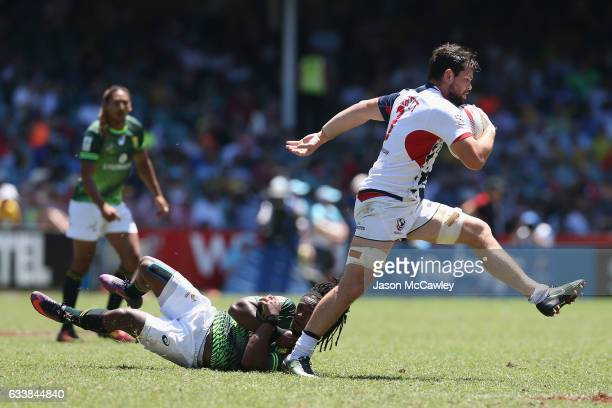 Danny Barrett of the USA makes a break during the Cup Quarter Final match between USA and South Africa in the 2017 HSBC Sydney Sevens at Allianz...