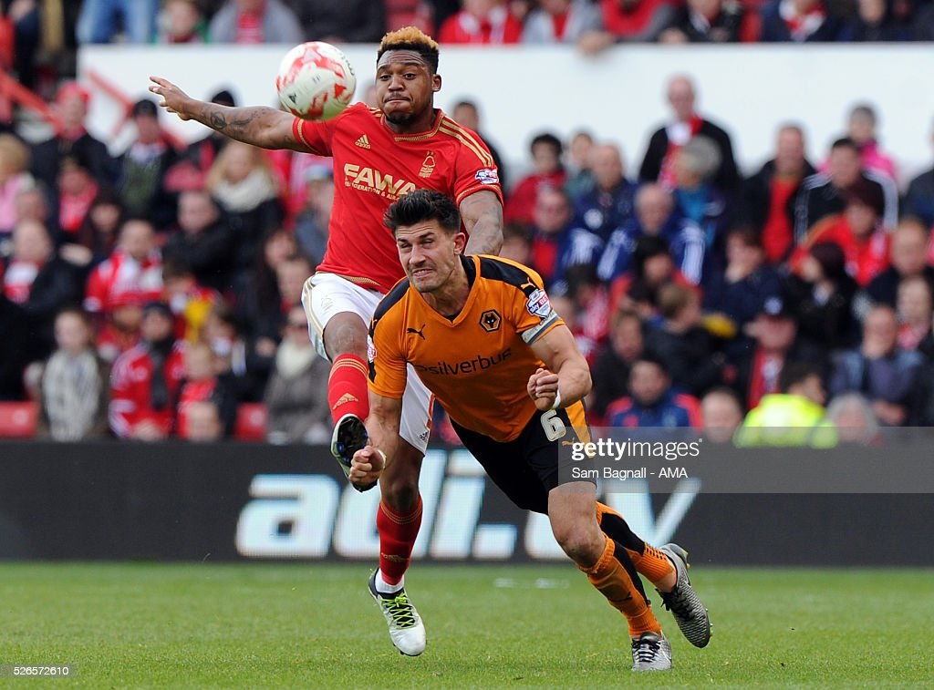 Danny Batth of Wolverhampton Wanderers and Britt Assombalonga of Nottingham Forest during the Sky Bet Championship match between Nottingham Forest and Wolverhampton Wanderers on April 30, 2016 in Nottingham, United Kingdom.