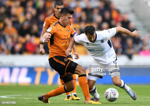Danny Batth of Wolverhampton Wanderers and Lee Gregory of Millwall during the Sky Bet Championship match between Wolverhampton and Millwall at...