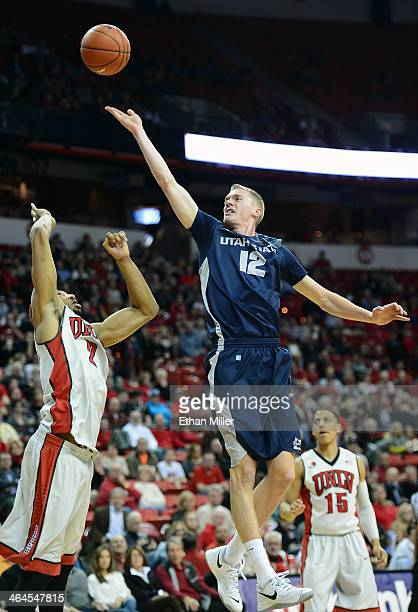 Danny Berger of the Utah State Aggies shoots against Khem Birch of the UNLV Rebels during their game at the Thomas Mack Center on January 22 2014 in...