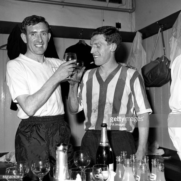 Danny Blanchflower captain of Tottenham Hotspur and Tony Kay captain of Sheffield Wednesday toast each other with champagne in the dressing room...