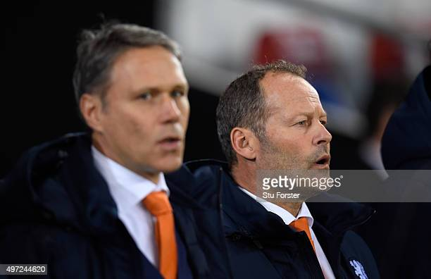 Danny Blind manager of Netherlands stands with assistant coach Marco Van Basten before the friendly International match between Wales and Netherlands...