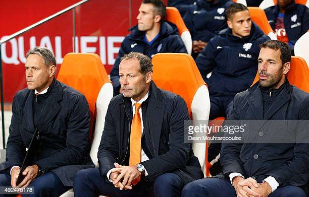 Danny Blind manager of the Netherlands looks dejected on the bench alongside assistant managers Marco van Basten and Ruud van Nistelrooy during the...