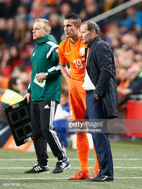 Danny Blind manager of the Netherlands talks to substitute Robin van Persie of the Netherlands during the UEFA EURO 2016 qualifying Group A match...