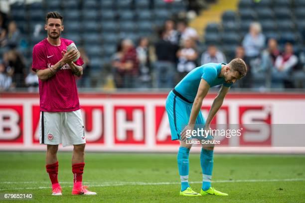 Danny Blum and Goalkeeper Lukas Hradecky of Frankfurt react after loosing the Bundesliga match between Eintracht Frankfurt and VfL Wolfsburg at...