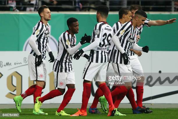 Danny Blum of Frankfurt celebrates his team's first goal with team matesduring the DFB Cup quarter final between Eintracht Frankfurt and Arminia...