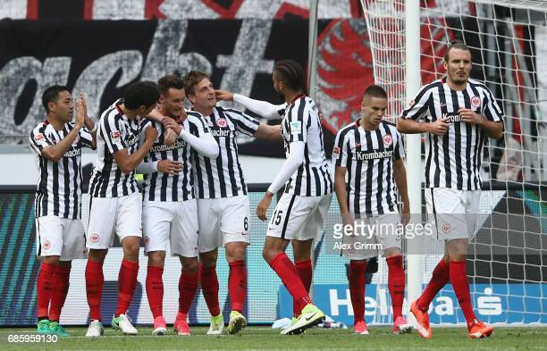 Danny Blum of Frankfurt celebrates his team's third goal with team mates during the Bundesliga match between Eintracht Frankfurt and RB Leipzig at...