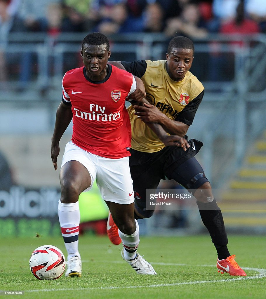 Danny Boateng of Arsenal XI holds off <a gi-track='captionPersonalityLinkClicked' href=/galleries/search?phrase=Kevin+Lisbie&family=editorial&specificpeople=226902 ng-click='$event.stopPropagation()'>Kevin Lisbie</a> of Orient during the pre season friendly match between Leyton Orient and Arsenal XI at The Matchroom Stadium on July 30, 2013 in London, England.
