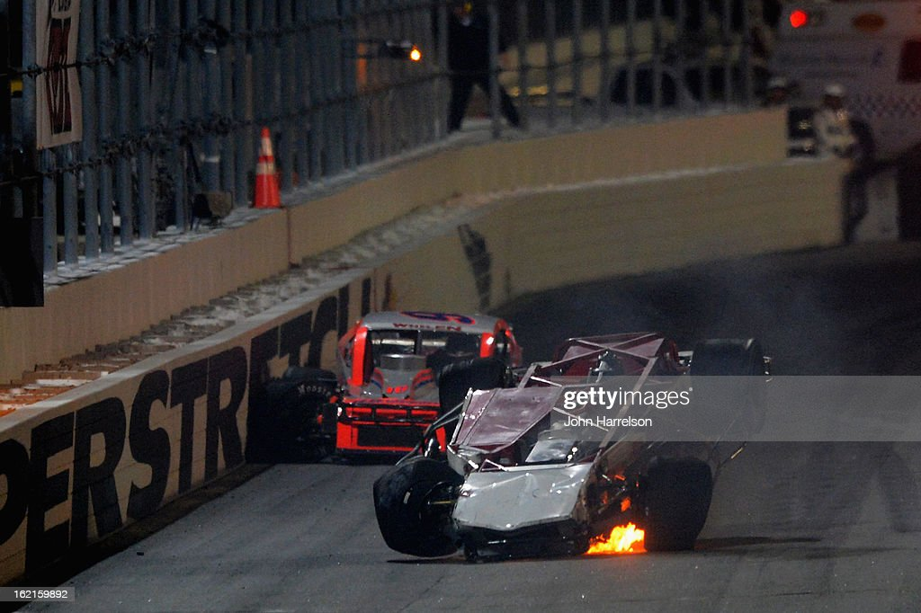 Danny Bohn, driver of the #65 Rustoleum/Rifenburg Construction Chevrolet, gets flipped over in a crash during the Whelen Modified Series UNOH Battle At The Beach at Daytona International Speedway on February 19, 2013 in Daytona Beach, Florida.