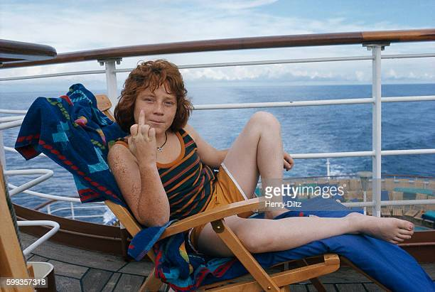Danny Bonaduce who plays the character Danny Partridge on The Partridge Family television series flips the bird while relaxing aboard a cruise ship...