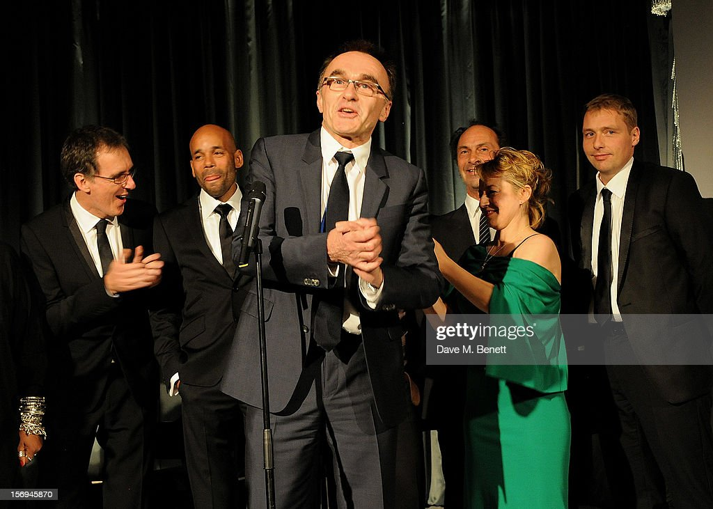 Danny Boyle (C) and his team from the London 2012 Opening Ceremony accept the Beyond Theatre award at the 58th London Evening Standard Theatre Awards in association with Burberry at The Savoy Hotel on November 25, 2012 in London, England.