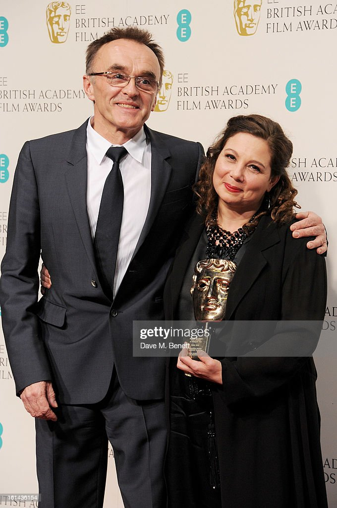 Danny Boyle (L) and Winner of the Outstanding British Contribution To Cinema award Tessa Ross poses in the Press Room at the EE British Academy Film Awards at The Royal Opera House on February 10, 2013 in London, England.