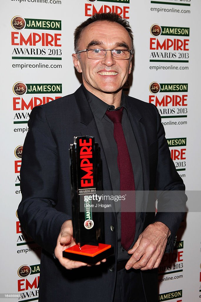 Danny Boyle poses with his Outstanding Contribution Award in the press room at the Jameson Empire Awards 2013 at Grosvenor House Hotel on March 24, 2013 in London, England.