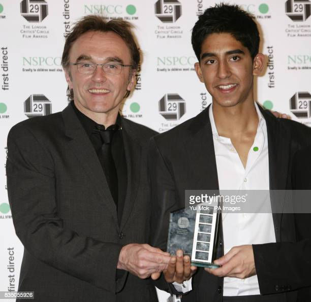 Danny Boyle with his Attenborough Film of the Year Award for Slumdog Millionaire with its star Dev Patel at The London Critics' Circle Film Awards at...