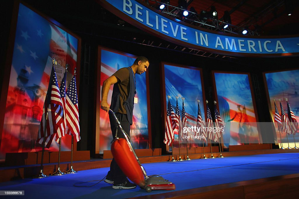 Danny Brandao vacuums the carpet as the stage is set up at the Boston Convention and Exhibition Center for Mitt Romney Campaign's election night event November 5, 2012 in Boston, Massachusetts. National polls show that Romney and U.S. President Barack Obama are in a virtual dead heat in the race for the presidential election on Tuesday.