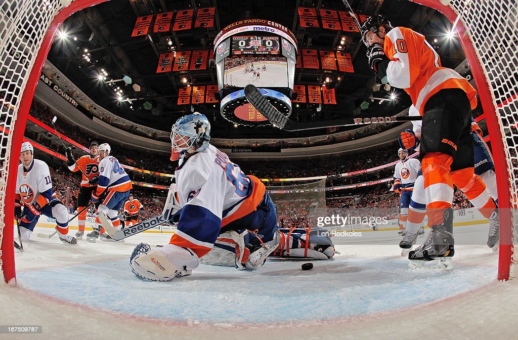 Danny Briere #48 (L) and <a gi-track='captionPersonalityLinkClicked' href=/galleries/search?phrase=Brayden+Schenn&family=editorial&specificpeople=4782304 ng-click='$event.stopPropagation()'>Brayden Schenn</a> #10 (R) of the Philadelphia Flyers celebrate Briere's first-period power-play goal against <a gi-track='captionPersonalityLinkClicked' href=/galleries/search?phrase=Kevin+Poulin&family=editorial&specificpeople=4952456 ng-click='$event.stopPropagation()'>Kevin Poulin</a> #60 of the New York Islanders on April 25, 2013 at the Wells Fargo Center in Philadelphia, Pennsylvania.