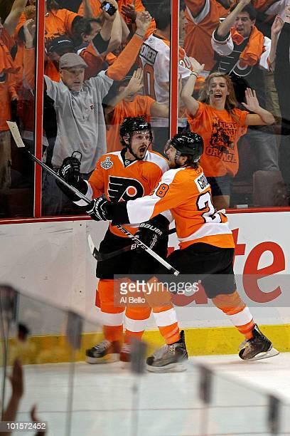 Danny Briere and Claude Giroux of the Philadelphia Flyers celebrate after Briere scored a goal in the first period against the Chicago Blackhawks in...