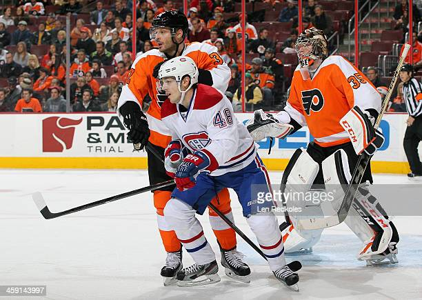 Danny Briere of the Montreal Canadiens battles in the crease against Mark Streit and Steve Mason of the Philadelphia Flyers on December 12 2013 at...