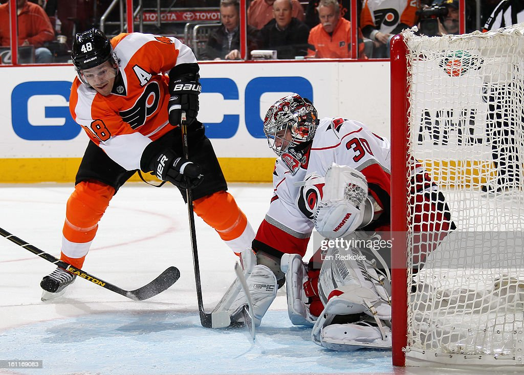 Danny Briere #48 of the Philadelphia Flyers attempts to poke the puck free from Cam Ward #30 of the Carolina Hurricanes on February 9, 2013 at the Wells Fargo Center in Philadelphia, Pennsylvania.