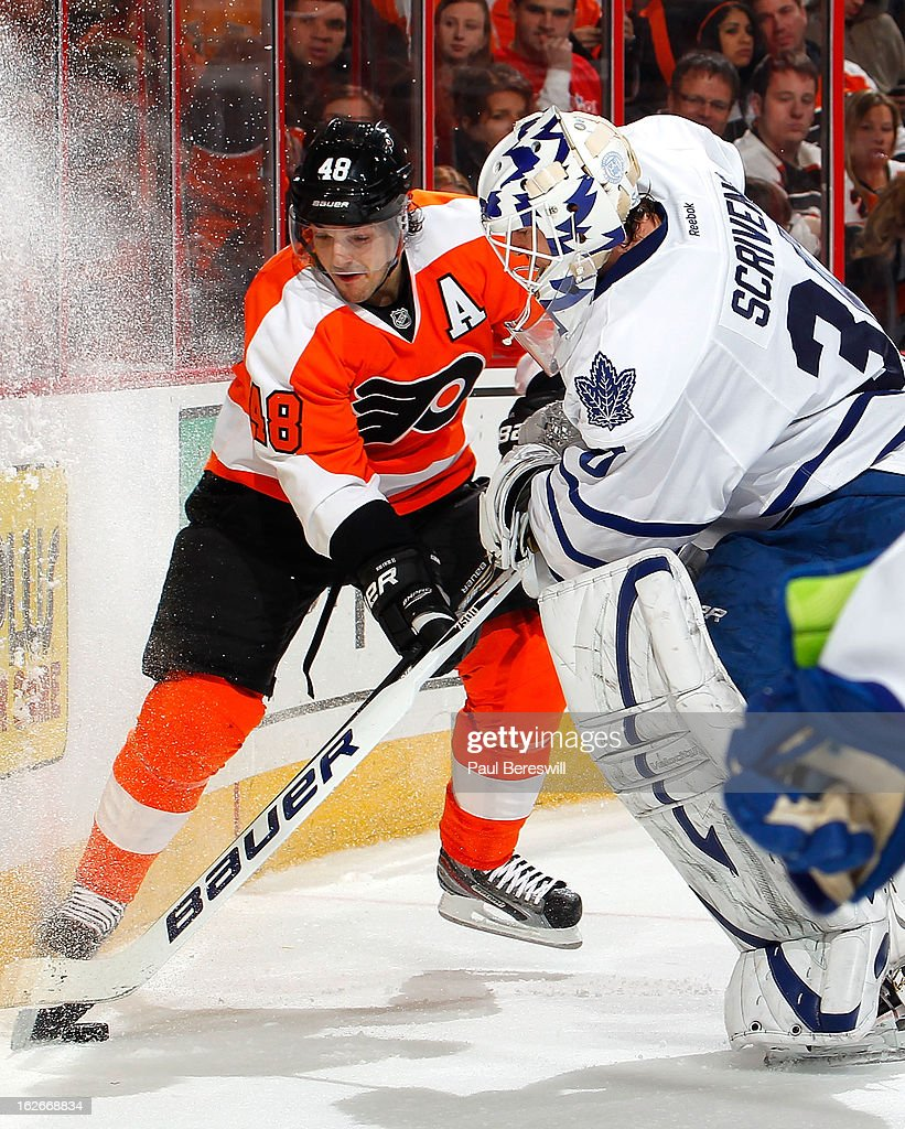 Danny Briere #48 of the Philadelphia Flyers battles with goalie <a gi-track='captionPersonalityLinkClicked' href=/galleries/search?phrase=Ben+Scrivens&family=editorial&specificpeople=7185205 ng-click='$event.stopPropagation()'>Ben Scrivens</a> #30 of the Toronto Maple Leafs for control of the puck behind the net in the second period of an NHL Hockey game at Wells Fargo Center on February 25, 2013 in Philadelphia, Pennsylvania.