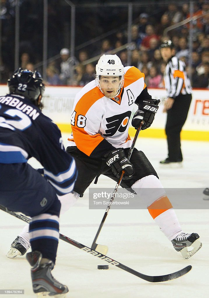 Danny Briere #48 of the Philadelphia Flyers carries the puck into the Winnipeg Jets end during their NHL game at MTS Centre on February 21, 2012 in Winnipeg, Manitoba, Canada.