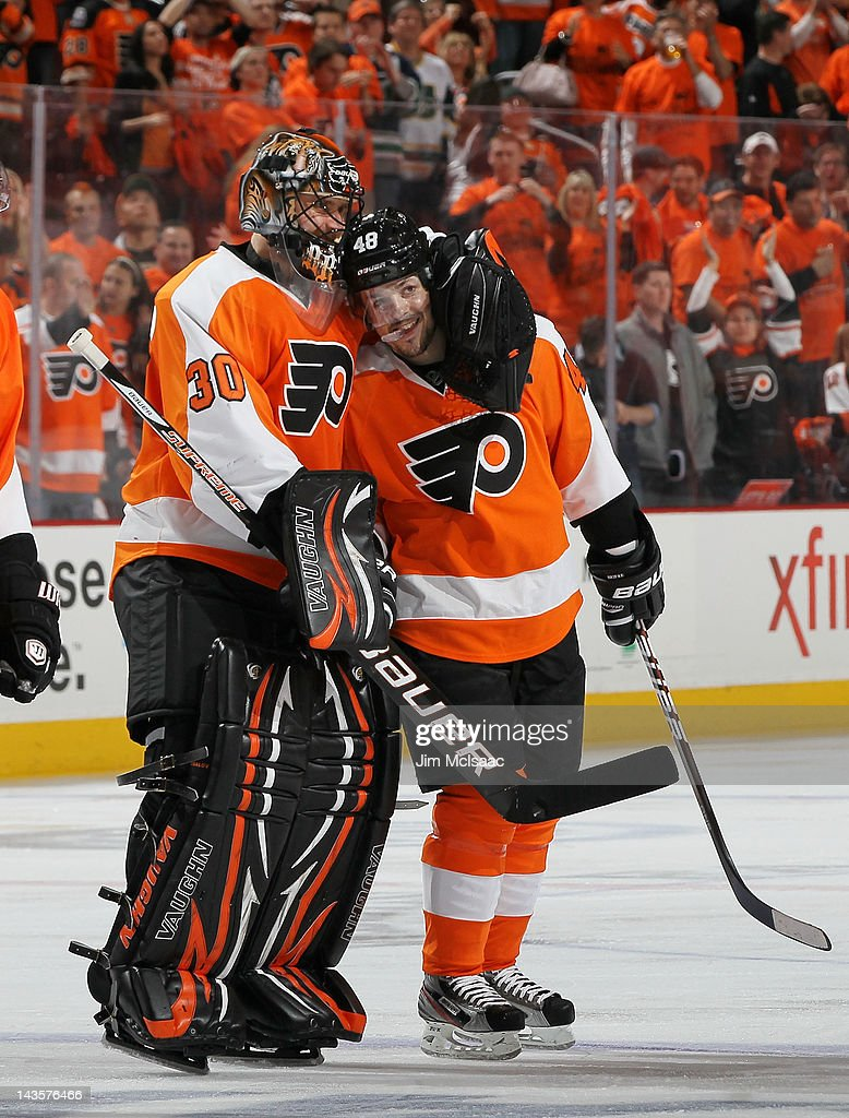 Danny Briere #48 of the Philadelphia Flyers celebrates his overtime goal against the New Jersey Devils with teammate <a gi-track='captionPersonalityLinkClicked' href=/galleries/search?phrase=Ilya+Bryzgalov&family=editorial&specificpeople=2285430 ng-click='$event.stopPropagation()'>Ilya Bryzgalov</a> #30 in Game One of the Eastern Conference Semifinals during the 2012 NHL Stanley Cup Playoffs at the Wells Fargo Center on April 29, 2012 in Philadelphia, Pennsylvania.