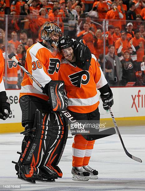 Danny Briere of the Philadelphia Flyers celebrates his overtime goal against the New Jersey Devils with teammate Ilya Bryzgalov in Game One of the...