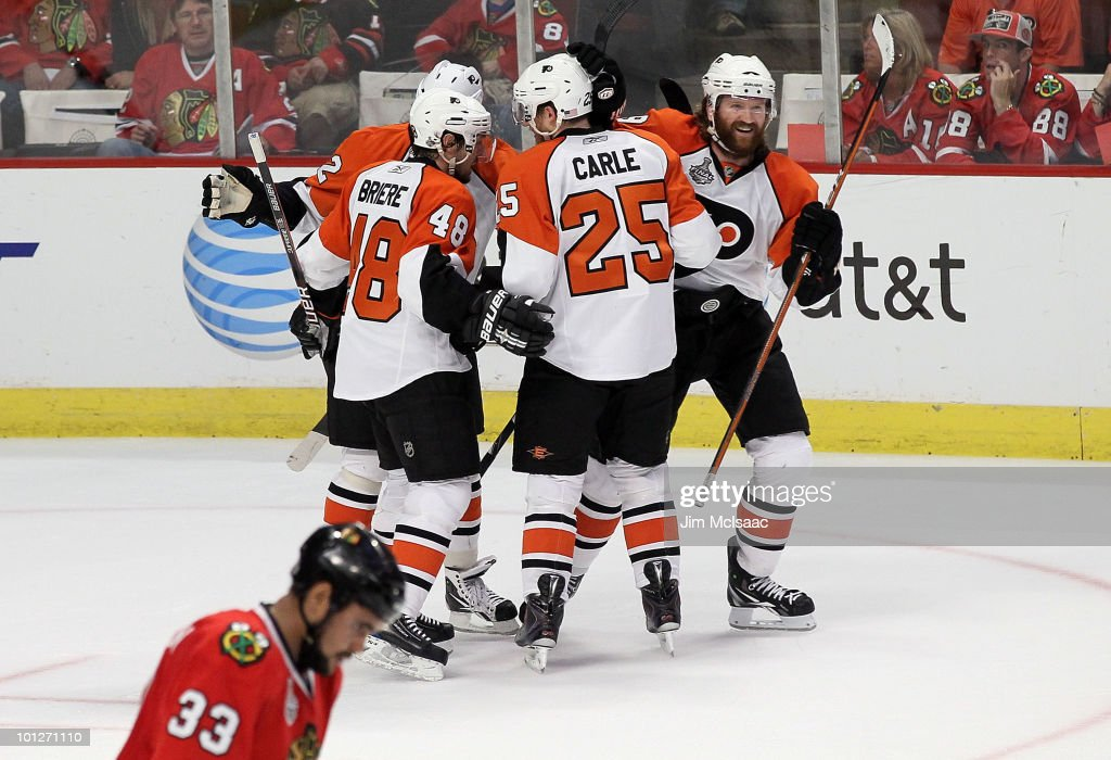 Danny Briere #48 of the Philadelphia Flyers celebrates with teammates <a gi-track='captionPersonalityLinkClicked' href=/galleries/search?phrase=Matt+Carle&family=editorial&specificpeople=582495 ng-click='$event.stopPropagation()'>Matt Carle</a> #25, <a gi-track='captionPersonalityLinkClicked' href=/galleries/search?phrase=Chris+Pronger&family=editorial&specificpeople=204521 ng-click='$event.stopPropagation()'>Chris Pronger</a> #20, <a gi-track='captionPersonalityLinkClicked' href=/galleries/search?phrase=Scott+Hartnell&family=editorial&specificpeople=201889 ng-click='$event.stopPropagation()'>Scott Hartnell</a> #19 as <a gi-track='captionPersonalityLinkClicked' href=/galleries/search?phrase=Dustin+Byfuglien&family=editorial&specificpeople=672505 ng-click='$event.stopPropagation()'>Dustin Byfuglien</a> #33 of the Chicago Blackhawks looks down in the first peiod of Game One of the 2010 NHL Stanley Cup Final at the United Center on May 29, 2010 in Chicago, Illinois.