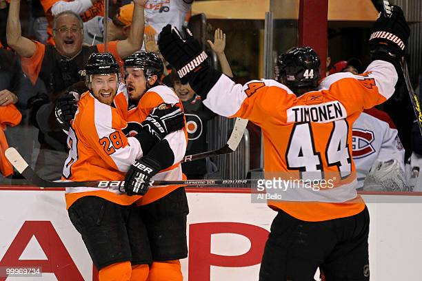 Danny Briere of the Philadelphia Flyers celebrates with teammates Claude Giroux and Kimmo Timonen after scoring a goal in the first period against...