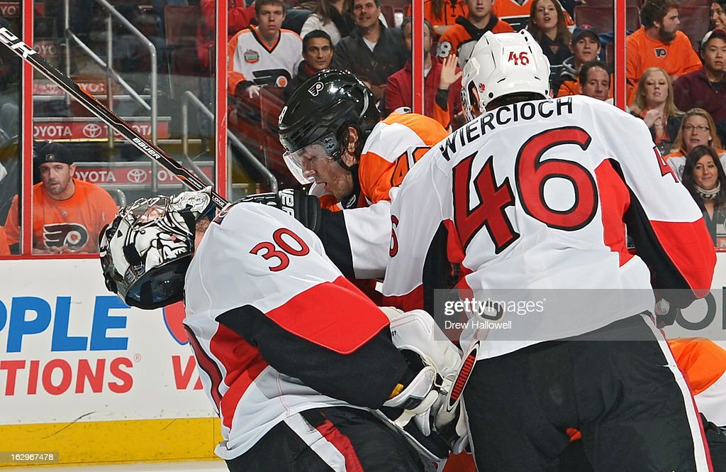 Danny Briere #48 of the Philadelphia Flyers collides with Ben Bishop #30 of the Ottawa Senators in front of Patrick Wiercioch #46 of the Ottawa Senators at the Wells Fargo Center on March 2, 2013 in Philadelphia, Pennsylvania.