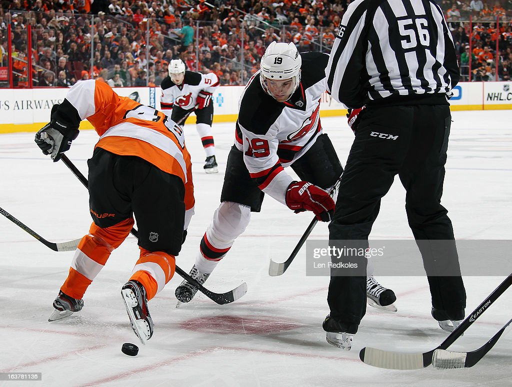 Danny Briere #48 of the Philadelphia Flyers faces off with <a gi-track='captionPersonalityLinkClicked' href=/galleries/search?phrase=Travis+Zajac&family=editorial&specificpeople=864182 ng-click='$event.stopPropagation()'>Travis Zajac</a> #19 of the New Jersey Devils on March 15, 2013 at the Wells Fargo Center in Philadelphia, Pennsylvania. The Flyers went on to defeat the Devils 2-1 in a shoot-out.
