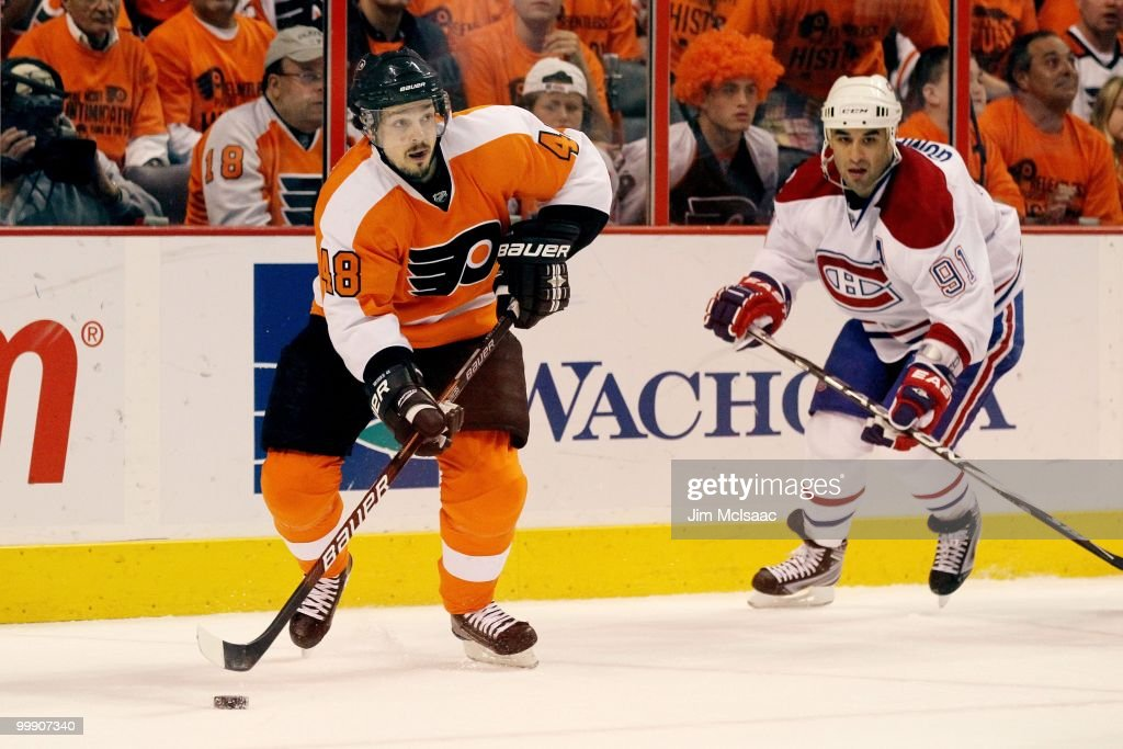 Danny Briere #48 of the Philadelphia Flyers handles the puck against Scott Gomez #91 of the Montreal Canadiens in Game 1 of the Eastern Conference Finals during the 2010 NHL Stanley Cup Playoffs at Wachovia Center on May 16, 2010 in Philadelphia, Pennsylvania.