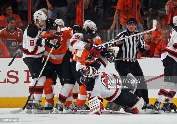 Danny Briere of the Philadelphia Flyers pulls down Martin Brodeur of the New Jersey Devils during a first period altercation in Game Two of the...