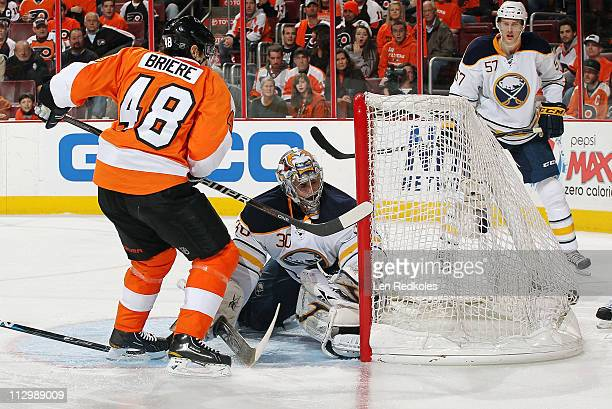 Danny Briere of the Philadelphia Flyers scores the gametying goal in the third period against Ryan Miller of the Buffalo Sabres in Game Five of the...