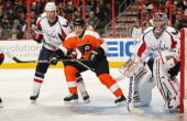 Danny Briere of the Philadelphia Flyers sets up in the crease against John Erskine and Semyon Varlamov of the Washington Capitals on January 18 2011...