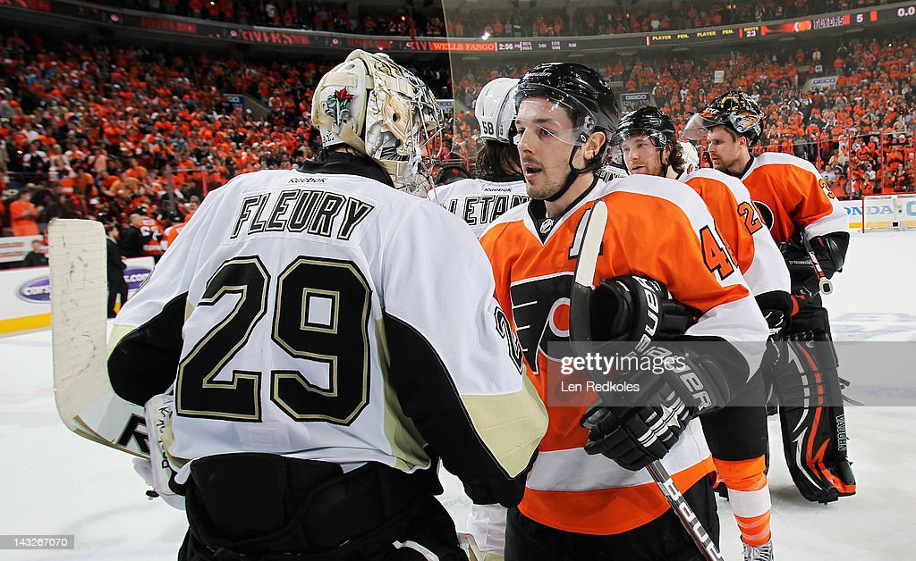 Danny Briere #48 of the Philadelphia Flyers shakes hands with <a gi-track='captionPersonalityLinkClicked' href=/galleries/search?phrase=Marc-Andre+Fleury&family=editorial&specificpeople=233779 ng-click='$event.stopPropagation()'>Marc-Andre Fleury</a> #29 of the Pittsburgh Penguins after Game Six of the Eastern Conference Quarterfinals during the 2012 NHL Stanley Cup Playoffs on April 22, 2012 at the Wells Fargo Center in Philadelphia, Pennsylvania. The Flyers defeated the Penguins 5-1 to win this series in six games.