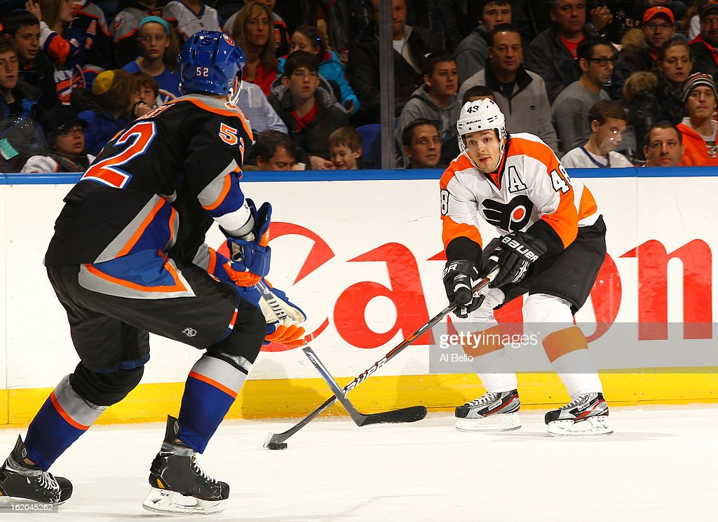 Danny Briere #48 of the Philadelphia Flyers skates against Joe Finley #52 of the New York Islanders during their game at Nassau Veterans Memorial Coliseum on February 18, 2013 in Uniondale, New York.