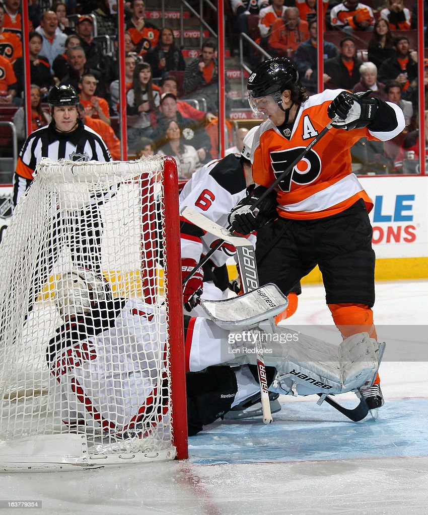 Danny Briere #48 of the Philadelphia Flyers stands in the crease after a scoring chance against goaltender <a gi-track='captionPersonalityLinkClicked' href=/galleries/search?phrase=Johan+Hedberg&family=editorial&specificpeople=202078 ng-click='$event.stopPropagation()'>Johan Hedberg</a> #1 of the New Jersey Devils on March 15, 2013 at the Wells Fargo Center in Philadelphia, Pennsylvania.