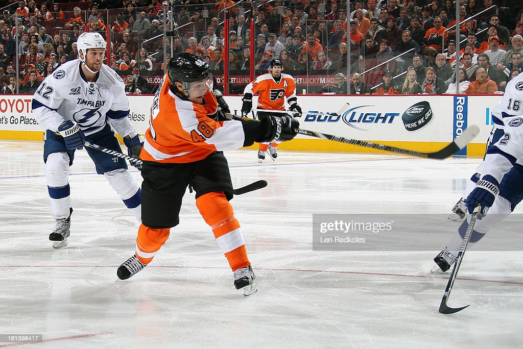 Danny Briere #48 of the Philadelphia Flyers takes a slapshot against Ryan Malone #12 of the Tampa Bay Lightning on February 5, 2013 at the Wells Fargo Center in Philadelphia, Pennsylvania.