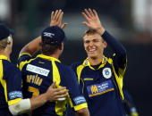 Danny Briggs of Hampshire celebrates taking the wicket of Peter Trego of Somerset with Sean Ervine during the Friends Provident T20 Final between...