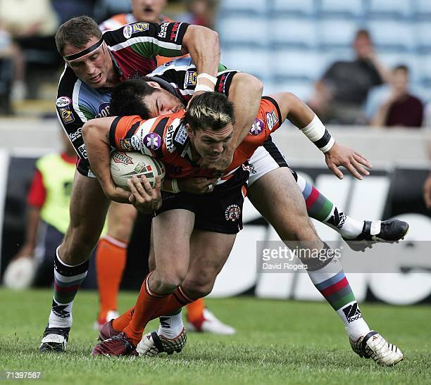 Danny Brough of Castleford is stopped by Pat Weisner and Robert Purdham during the Super League XI match between Harlequins RL and Castleford Tigers...