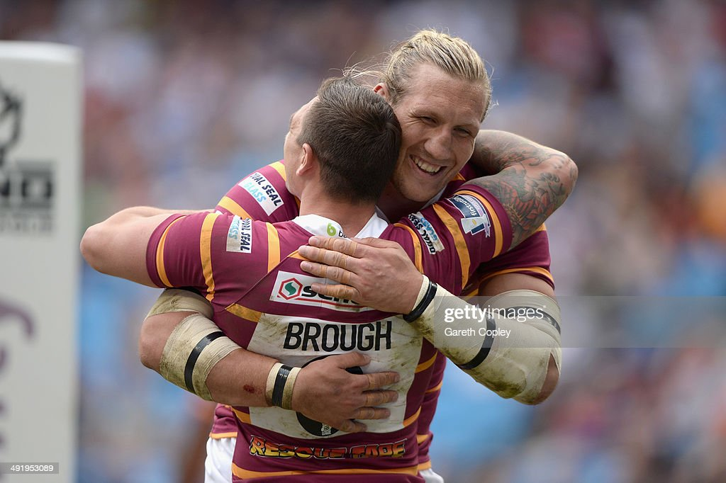 Danny Brough of Huddersfield Giants celebrates with Eorl Crabtree after scoring a second half try during the Super League match between Huddersfield Giants and Bradford Bulls at Etihad Stadium on May 18, 2014 in Manchester, England.